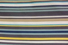 Soft carpet in multi-colored stripes stock image