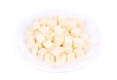 Soft cheese cubes on plate. Stock Photography
