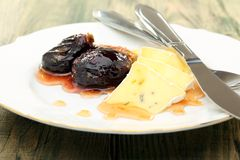 Soft cheese with figs and honey sauce. Stock Image