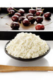 Soft cheese with fresh ripe cherry Stock Photography