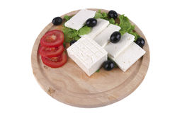 Soft cheese with olives on plate Stock Images