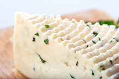 Soft cheese sector with herbs close-up Royalty Free Stock Photos