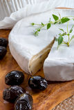 Soft cheese with spicy olives Royalty Free Stock Image
