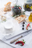 Soft cheese with spicy olives Stock Image