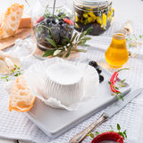 Soft cheese with spicy olives Stock Photo