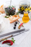 Soft cheese with spicy olives Royalty Free Stock Images