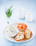 Soft cheese spread, smoked wild salmon and baguette. Selective focus Royalty Free Stock Images