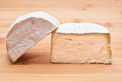 Soft cheese on a wooden board Stock Photos