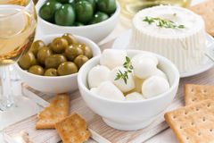 Soft cheeses, crackers and pickles for wine, close-up Stock Image
