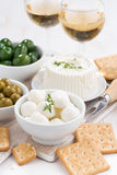 Soft cheeses, crackers and pickles for wine, vertical, top view Stock Photo