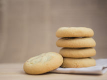 Soft and chewy chocolate chips and raisin cookies. On brown paper stock photography