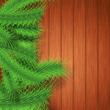 Soft Christmas tree branches over wood Royalty Free Stock Images