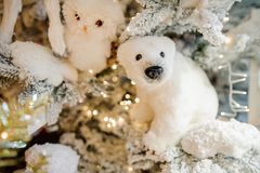Soft Christmas tree decoration toy in the form of a white polar bear Stock Photography