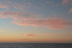 A soft cloud background with a pastel colored cloudscape. Stock Image
