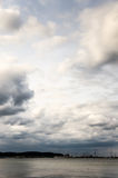 Soft clouds sea side Stock Images
