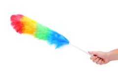 Soft colorful duster with plastic handle. On a white background Royalty Free Stock Image