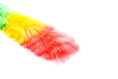 Soft colorful duster with plastic handle. On white background Stock Photos