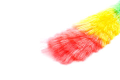 Soft colorful duster with plastic handle. On white background Stock Images