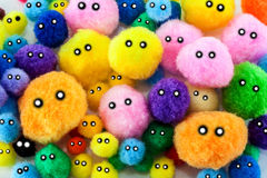 Soft colorful pompoms faces Royalty Free Stock Photo