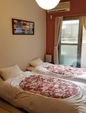 Two comfortable beds with soft bedding in a rented room in Kyoto, Japan stock image