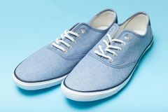 Soft comfortable blue sneakers on a blue background.  stock photos