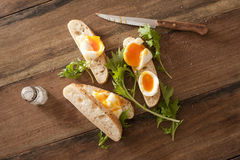 Soft cooked eggs sliced and served on bread Royalty Free Stock Image