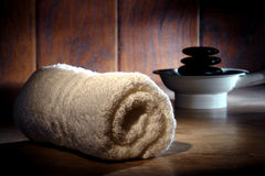 Soft Cotton White Towel and Polished Stones Stock Images