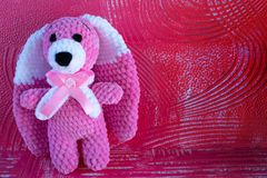 Soft crochet toy hare. Pink with white. stock photos