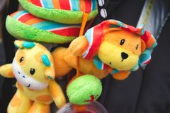 Soft cuddly toys hanging from a baby`s pushchair stock image