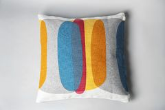 Soft decorative pillow. On light background stock image