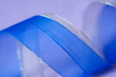 Soft defocused background blue silver ribbon on violet Stock Image