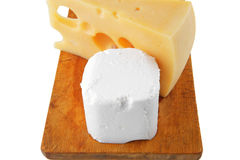 Soft delicacy cheeses on board Stock Photography