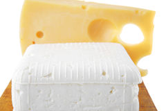 Soft delicacy cheeses on board Stock Photo