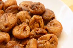 Soft dried figs on a white plate Royalty Free Stock Photography