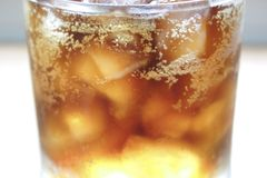 Soft Drink. (cola) with ice. Very shallow DOF stock images