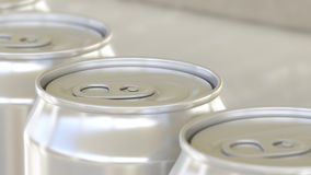 Soft drink or beer production line. Aluminum cans on industrial conveyor, shallow focus. Recycling ecologic packaging royalty free stock images