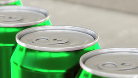 Soft drink or beer production line. Green aluminum cans on industrial conveyor, shallow focus. Recycling ecologic royalty free stock photography