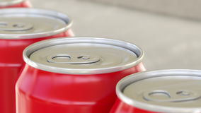 Soft drink or beer production line. Red aluminum cans on industrial conveyor, shallow focus. Recycling ecologic Stock Photos