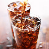 Soft drink being poured into glass Stock Photo
