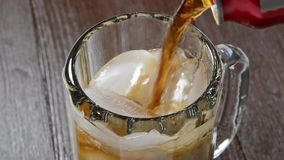 Soft drink being poured into a mug stock footage