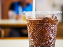 Soft drink bokeh. In a plastic glass Royalty Free Stock Images