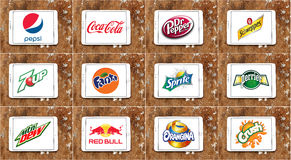 Soft drink brands and logos. Logos and brands of worldwide soft drinks manufacturers on white tablet on rusted wooden background. brands like pepsi , cocacola Royalty Free Stock Photography