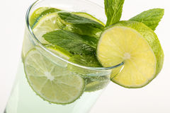 Soft drink decorated with mint and lime Royalty Free Stock Photo