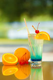 Soft drink and fruit. Non-alcoholic drink and fruit on a table with a blurred background Stock Images