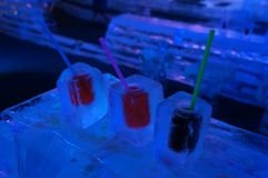A soft drink in ice glass and ice bar counter royalty free stock photo