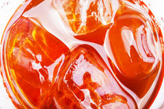 Soft drink with ice in glass close up. Close up soft drink with ice in glass shot Stock Photos
