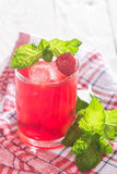 Soft drink with ice and mint. Refreshing non-alcoholic soft drink with ice and mint Royalty Free Stock Images