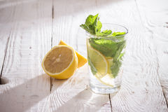 Soft drink with ice and mint. Refreshing non-alcoholic soft drink with ice and mint Stock Images