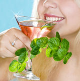 Soft drink and  mint in  hand Royalty Free Stock Images