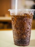 Soft drink in a plastic glass. Soft drink bokeh in a plastic glass Royalty Free Stock Image